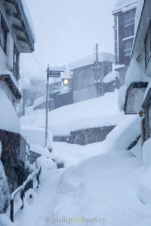Street with covered in snow houses, Nozawaonsen, Japan