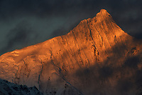 Meili Snow Mountain/Kawagebo/Kawagarbo, 6740 m, a Sacred mountain for Tibetan Buddhists, yet unclimbed, Yunnan, China covered in sunset light.