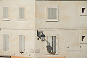 building with closed shutters France Arles