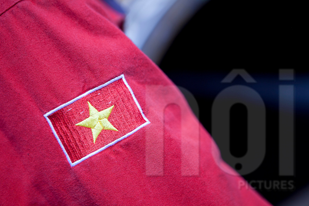 Uniform of a worker with the vietnamese flag embroidered on it, oil rig offshore of Vung Tau, Vietnam, Southeast Asia