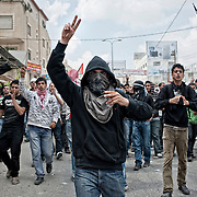 Young palestinian demonstrators are defying Israeli army near the Kalandia checkpoint, on the Nakba day. Ramallah, Westbank - May 15th 2011.