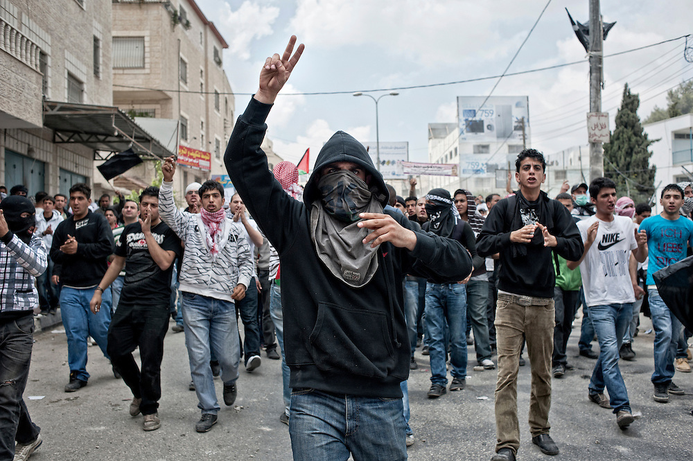 Young palestinian demonstrators are defying Israeli army near the Kalandia checkpoint, on the Nakba day. Ramallah, Westbank - May 15th 2011.
