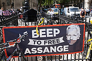 Scene outside the Royal Courts of Justice as protesters gather and place banners in support of Julian Assange during his latest High Court hearing on 11th August 2021 in London, United Kingdom. Following Judge Vanessa Baraitser's earlier ruling that he was a 'suicide risk' if extradited to the US, she denied his extradition. Today, the court ruled that the United States can resume it's appeal to extradite Assange, against this decision. Assange has been held in prison since his conviction in 2019 following approximately 7 years claiming political asylum in the Ecuadorian Embassy in London.