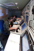 The control room of an Israeli Air force (IAF) IAI Heron (IAI Shoval) an Unmanned Aerial Vehicle (UAV) developed by the Malat division of Israel Aerospace Industries. Faces and equipment are blurred for security reasons