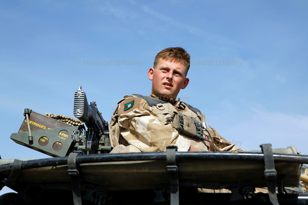 """Mcc0018106 . SundayTelegraph..For the Sunday Telegraph..A soldier on """"top cover"""" of his vehicle whilst on patrol with soldiers from the 2 Yorks in Nad e'Ali , the district in Helmand province where last week 5 soldiers were killed by a rogue Afghan policeman.....Afghanistan 7 November 09"""