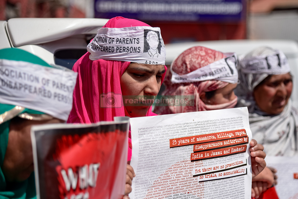 March 28, 2019 - Srinagar, Jammu and Kashmir, India - Members of Association of Parents of Disappeared Person (APDP) are seen holding Placards during a silent protest in Srinagar..A demonstration of Association of Parents of Disappeared Persons (APDP) held in summer capital Srinagar today seeking information about their beloved ones. The APDP is demanding the setting up of a commission to probe the disappearances of people in Kashmir. According to the APDP, some 8,000 to 10,000 people have gone missing since the beginning of the Kashmir conflict in 1989. (Credit Image: © Idrees Abbas/SOPA Images via ZUMA Wire)
