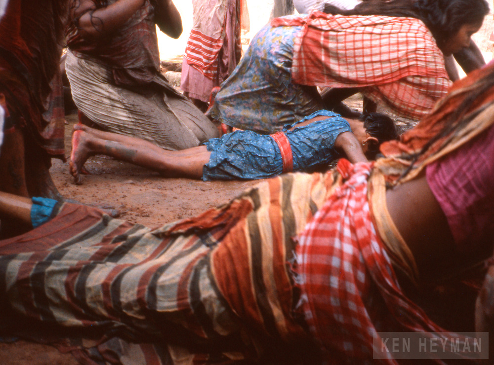 Calcutta, India, where barren women crawl two blocks believing they'll get pregnant as people throw water on them.