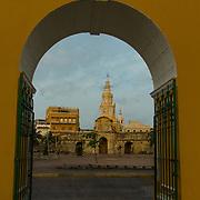 The venerable clock tower - Torre del Reloj - looks out over the Plaza de la Paz in the Old City - Cuidad Vieja - Cartagena, Colombia.