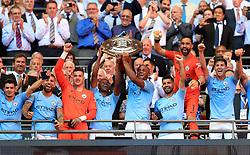 Manchester City's Vincent Kompany and Fernandinho lift the Community Shield trophy after the Community Shield match at Wembley Stadium, London
