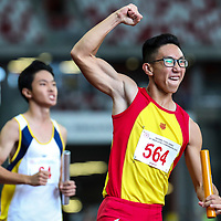 Tedd Toh (#564) celebrates after anchoring Hwa Chong Institution to win the B Division boys' 4x100m final. (Photo © Lim Yong Teck/Red Sports)
