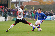 Adrian Clifton of Maidenhead United tackles Ben Thompson of Portsmouth during the The FA Cup 1st round match between Maidenhead United and Portsmouth at York Road, Maidenhead, United Kingdom on 10 November 2018.