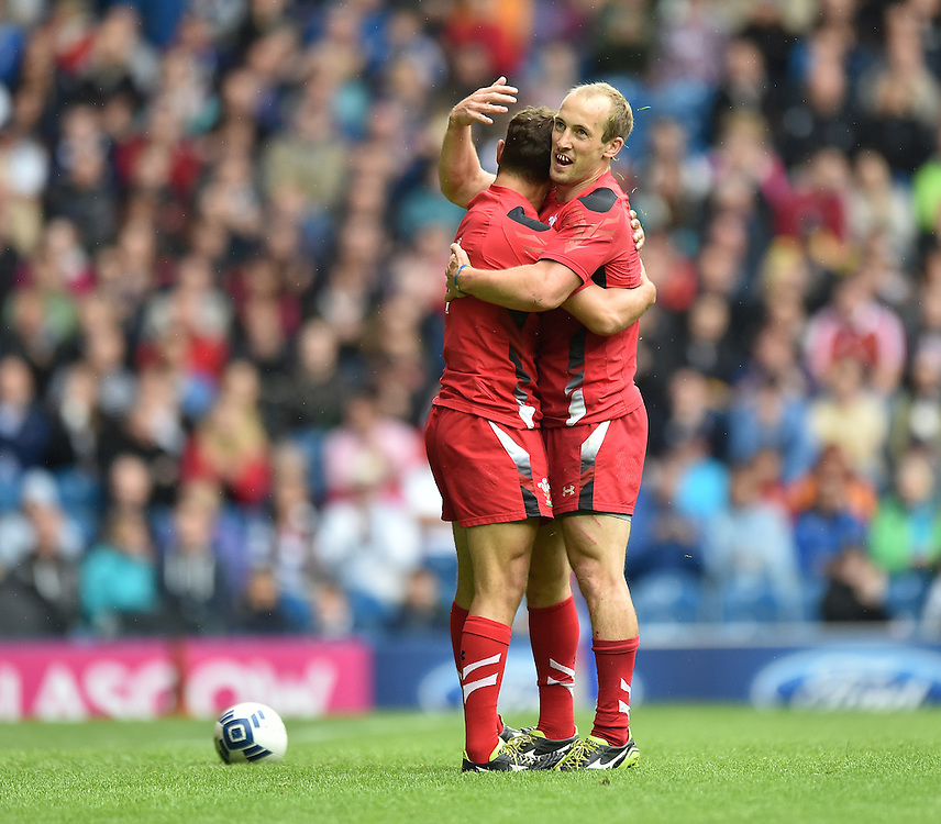Wales's Luke Treharne, left, celebrates scoring his sides fifth try with team-mate Lee Williams<br /> <br /> Kenya Vs Wales - men's placing 5-8 match<br /> <br /> Photographer Chris Vaughan/CameraSport<br /> <br /> 20th Commonwealth Games - Day 4 - Sunday 27th July 2014 - Rugby Sevens - Ibrox Stadium - Glasgow - UK<br /> <br /> © CameraSport - 43 Linden Ave. Countesthorpe. Leicester. England. LE8 5PG - Tel: +44 (0) 116 277 4147 - admin@camerasport.com - www.camerasport.com