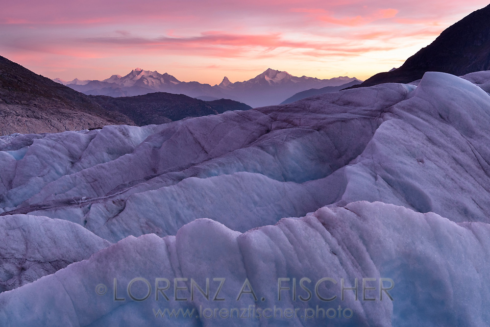 Pink cirrostratus clouds above the Mischabel group, the Matterhorn and the Weisshorn and the glacier Grosser Aletschgletscher, Fiescheralp, Valais, Switzerland<br /> <br /> Auf dem Gletscher Grosser Aletschgletscher, Fiescheralp, Wallis, Schweiz