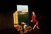 Mennonite siblings play at home.