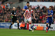 Joe Allen of Stoke city goes past Diego Costa of Chelsea. Premier league match, Stoke City v Chelsea at the Bet365 Stadium in Stoke on Trent, Staffs on Saturday 18th March 2017.<br /> pic by Andrew Orchard, Andrew Orchard sports photography.