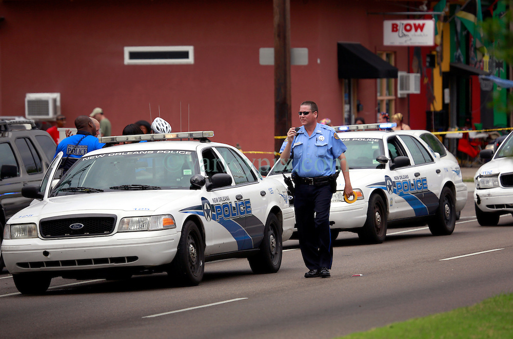 28 April 2013. New Orleans, Louisiana,  USA. .Police and paramedics respond to a shooting in a house on the corner of Gentilly Blvd and Broad St in New Orleans. The shooting occurred just a block from the main entrance to the New Orleans JAzz and Heritage Festival. Photo; Charlie Varley.