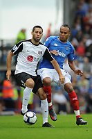 Fotball<br /> England<br /> Foto: Fotosports/Digitalsport<br /> NORWAY ONLY<br /> <br /> Clint Dempsey (Fulham) attempts to evade Younes Kaboul (Portsmouth) <br /> <br /> 15.08.09 Portsmouth v Fulham Barclays Premier League Fratton Park