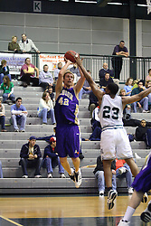 30 December 2006: Darius Gant attempts to block a shot by Drew Yancey. The Titans outscored the Britons by a score of 94-80. The Britons of Albion College visited the Illinois Wesleyan Titans at the Shirk Center in Bloomington Illinois.<br />