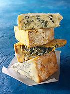 British Blue Cheese Photos -From the top - Blue Vinney, Stilton, Blacksticks Blue, Creamy Stilton. Funky Stock Photos.