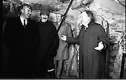 Taoiseach Visits Newgrange.  (R70)..1987..21.12.1987..12.21.1987..21st December 1987..An Taoiseach, Charles Haughey TD, visited the Newgrange Stoneage Chamber to view thwe annual Winter Soltice. As the sun rose, An Taoiseach watched as the sunrise traced its path along the floor of the chamber...Picture shows An Taoiseach, Charles Haughey TD, sharing a joke with officials from the Newgrange Visitor Centre.
