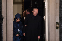 London, UK. 3 December, 2019. Recep Tayyip Erdoğan, President of Turkey, leaves with his wife Emine Erdoğan following a reception for NATO leaders at 10 Downing Street on the eve of the military alliance's 70th anniversary summit at a luxury hotel near Watford.