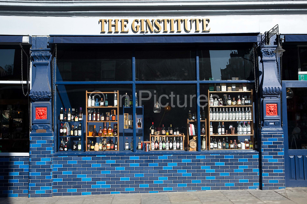 A bright and colourful tiled shopfront at The Ginstitute gin bar off Portobello Road in Notting Hill on the 26th March 2018 in West London, United Kingdom.