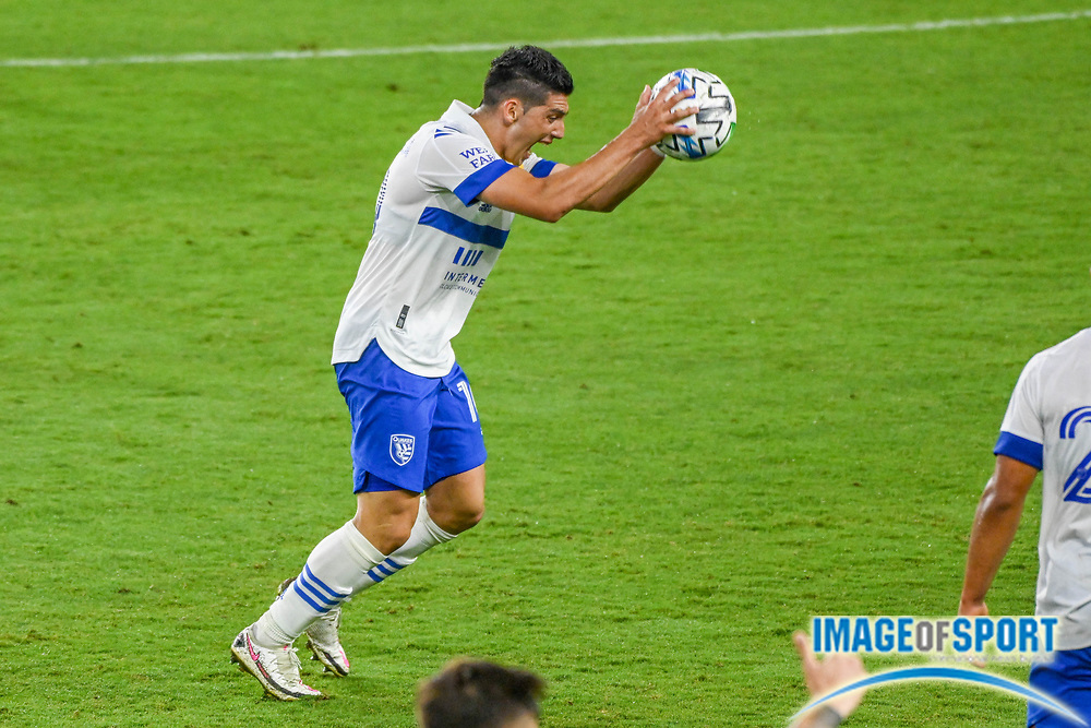 San Jose Earthquakes forward Cristian Espinoza (10) slams the ball into the ground, resulting in a yellow card, during a MLS soccer game, Sunday, Sept. 27, 2020, in Los Angeles. The San Jose Earthquakes defeated LAFC 2-1.(Dylan Stewart/Image of Sport)