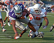 Kansas State quarterback Josh Freeman (1) dives over the goal line for the winning touchdown past Oklahoma State defensive back Perrish Cox (16) with a minute left in the game at Bill Snyder Family Stadium in Manhattan, Kansas, October 7, 2006.  The Wildcats beat the Cowboys 31-27.<br />