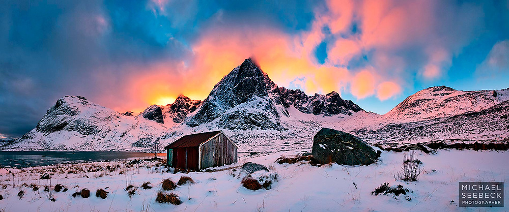 The sun sets behind a cloud-piercing mountain on the Lofoten Peninsula.<br /> <br /> Limited Edition of 125