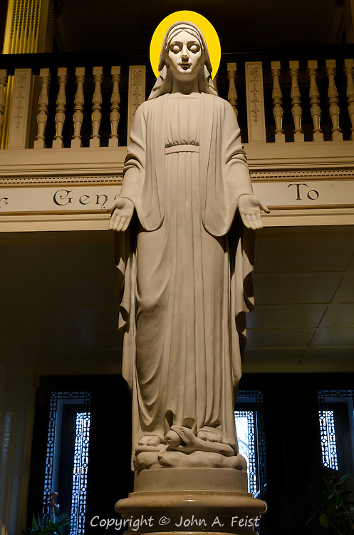 This is a life sized statue of Mary in the entrance hallway of the Loyola House of Retreats.  She looks so serene, peaceful and welcoming.  I chose to imitate the renaissance artists and add the halo.