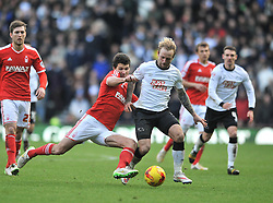 Derby County's Johnny Russell is challenged by Nottingham Forest's Eric Lichaj - Photo mandatory by-line: Dougie Allward/JMP - Mobile: 07966 386802 - 17/01/2015 - SPORT - Football - Derby - iPro Stadium - Derby County v Nottingham Forest - Sky Bet Championship
