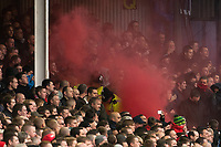 Football - 2012 / 2013 Premier League - Everton vs. Liverpool<br /> Two police officers attempt to put out a smoke grenade in the Liverpool section at Goodison Park