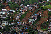 Aerial view of houses damaged by landslides in Nova Friburgo, Brazil, Sunday, Jan. 16, 2011.<br /> <br /> A series of flash floods and mudslides struck several cities in Rio de Janeiro State, destroying houses, roads and more. More than 900 people are reported to have been killed and over 300 remain missing in this, Brazil's worst-ever natural disaster.