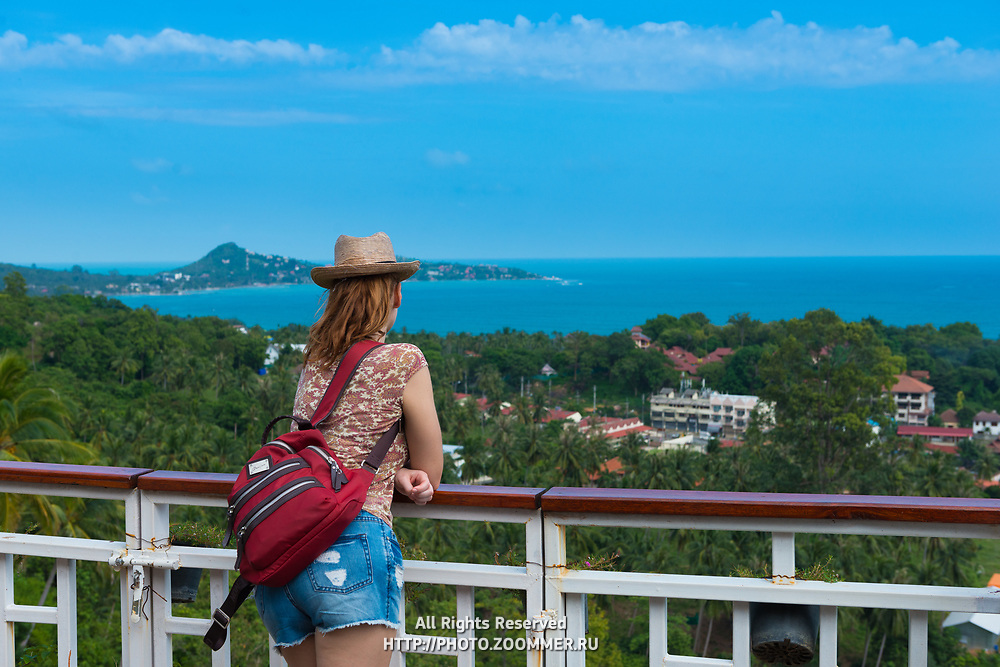 Tourist girl standing on observation deck Lamai viewpoint in Samui island, Thailand