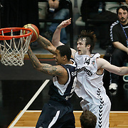 Besiktas's Andrew James OGILVY (R) and Efes Pilsen's Lawrence ROBERTS (L) during their Turkish Basketball league derby match Besiktas between Efes Pilsen at the BJK Akatlar Arena in Istanbul Turkey on Saturday 30 April 2011. Photo by TURKPIX