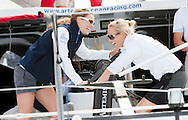 Zara Phillips and Winter Olympic's gold medallist Amy Williams get to work on the grinder while gybing down the Solent during the Artemis Challenge.