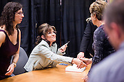 """23 NOVEMBER 2010 - PHOENIX, AZ:  SARAH PALIN greets customers and signs copies of her new book """"America by Heart"""" at the Barnes and Noble store in Phoenix Tuesday night, Nov. 23. It was the kick off of her book tour to support America by Heart. Palin is frequently mentioned as a possible Republican candidate for US President in 2012.  Photo by Jack Kurtz"""