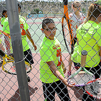 061814       Cable Hoover<br /> <br /> Steven Salas and his fellow campers select rackets during the Gallup Bengals tennis camp at Ford Canyon Park in Gallup Wednesday.