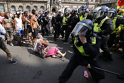 © Licensed to London News Pictures. 19/07/2021. London, UK. Police in riot gear clash with protesters trying to reach Whitehall from Parliament Square in central London on Freedom Day. All covid regulations in England are being scrapped from today even though infections and hospitalisations are on the increase. Photo credit: Peter Macdiarmid/LNP
