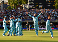 England Are World Champions - Joe Root of England, Jonny Bairstow of England and the England team celebrate after Martin Guptill of New Zealand is run out in the super over and England win the World Cup during the ICC Cricket World Cup 2019 Final match between New Zealand and England at Lord's Cricket Ground, St John's Wood, United Kingdom on 14 July 2019.