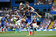 Oscar of Chelsea blocks the ball from Matthew Lowton of Burnley. Premier league match, Chelsea v Burnley at Stamford Bridge in London on Saturday 27th August 2016.<br /> pic by John Patrick Fletcher, Andrew Orchard sports photography.
