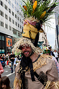 New York, NY - April 16, 2017. A man dressed as the scarecrow in The Wizard of Oz  at New York's annual Easter Bonnet Parade and Festival on Fifth Avenue.