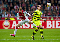 17/09/15 UEFA EUROPA LEAGUE GROUP STAGE<br /> AJAX v CELTIC<br /> AMSTERDAM ARENA - HOLLAND<br /> Celtic's Stefan Johansen (right) battles with Daley Sinkgraven