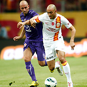 Galatasaray's Nordin Amrabat (R) and ACF Fiorentina's during their friendly soccer match Galatasaray between ACF Fiorentina at the TT Arena in istanbul Turkey on Wednesday 08 August 2012. Photo by TURKPIX