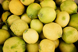 Heap of yellow lemons for sale at market, Puglia, Italy
