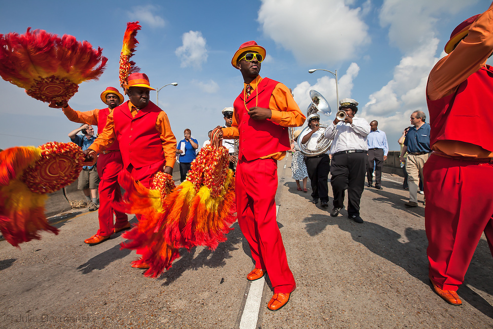 The Revolution Social Aid and Pleasure Club march over the Claiborne Bridge into the Lower 9th Ward to mark the fourth anniversary of hurricane Katrina on Aug. 29, 2009, in New Orleans, La.