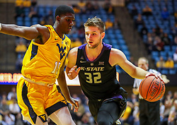 Feb 18, 2019; Morgantown, WV, USA; Kansas State Wildcats forward Dean Wade (32) drives against West Virginia Mountaineers forward Lamont West (15) during the first half at WVU Coliseum. Mandatory Credit: Ben Queen-USA TODAY Sports