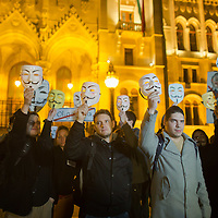 Participants attend a local event of the million masked march movement in front of the Hungarian Parliament in Budapest, Hungary on November 05, 2014. ATTILA VOLGYI