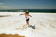 Little girl running at beach