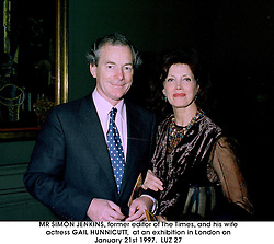 MR SIMON JENKINS, former editor of The Times, and his wife actress GAIL HUNNICUTT,  at an exhibition in London on January 21st 1997.LUZ 27